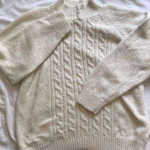 A cream comfortable sweater